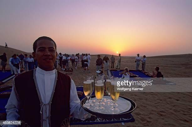 United Arab Emirates Dubai Desert Conservation Reserve Tourists Champagne