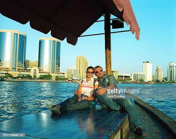 United Arab Emirates, Dubai, Dubai Creek, couple on abra, portrait