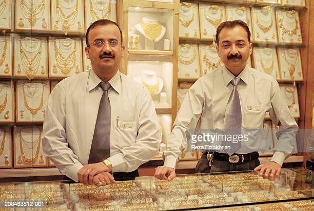 United Arab Emirates, Dubai, men working in gold jewelry store