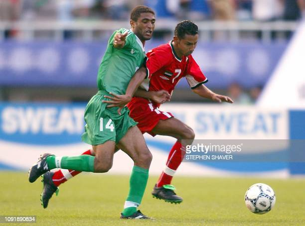 United Arab Emirates' Faisal Ali Hassan Salem Bin Aqeel and Yemen's Ahmed Salem Ahmed Al Zuraial fight for the ball during a match 30 September 2002...