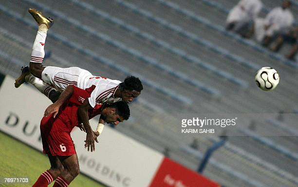 United Arab Emirate's Faisal Khalil dives onto the back of Lebanon's Faisal Antar to head the ball during an international football friendly in Dubai...