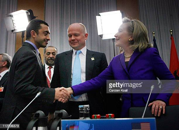 United Arab Emirates Foreign Minister Abdallah bin Zayid alNuhayyan greets US Secretary of State Hillary Clinton in front of Foreign Secretary...