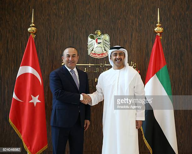 United Arab Emirates' Foreign Minister Abdullah bin Zayed Al Nahyan and Turkish Foreign Minister Mevlut Cavusoglu shake each other's hands before...