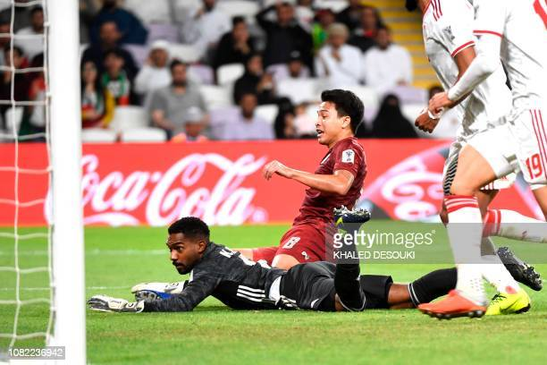 United Arab Emirates' goalkeeper Ali Housani misses the goal by Thailand's midfielder Thitiphan Puangjan during the 2019 AFC Asian Cup group A...