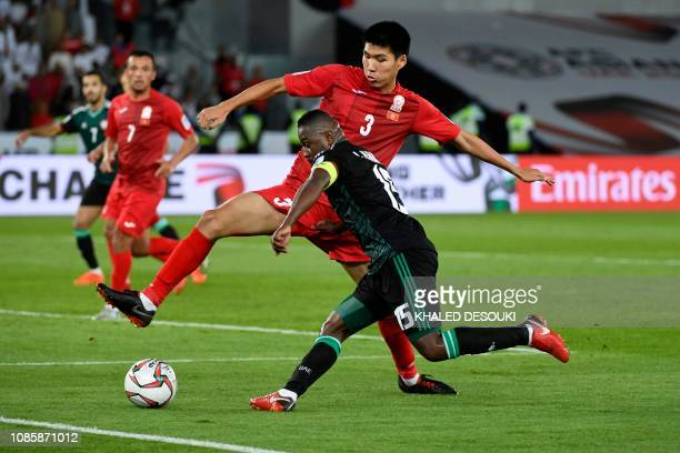 United Arab Emirates' midfielder Ismail Al Hamadi vies for the ball with Kirghyzstan's defender Tamirlan Kozubaev during the 2019 AFC Asian Cup Round...