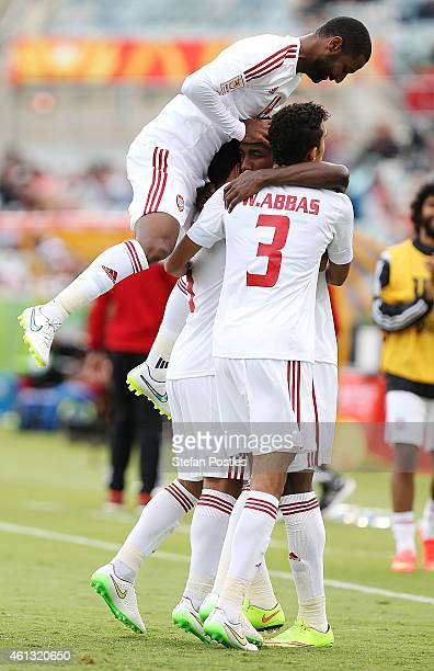 United Arab Emirates players celebrate a goal during the 2015 Asian Cup match between the United Arab Emirates and Qatar at Canberra Stadium on...