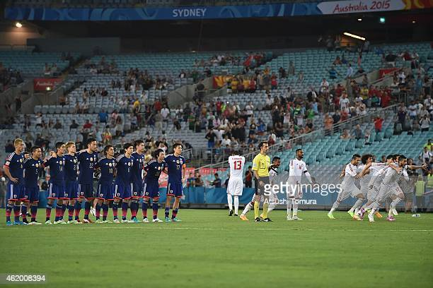 United Arab Emirates players celebrate winning the penalty shoot out during the 2015 Asian Cup Quarter Final match between Japan and the United Arab...