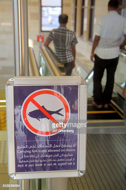 United Arab Emirates UAE UAE Middle East Dubai Deira Al Ras Metro Station subway public transportation inside sign carrying fish not allowed