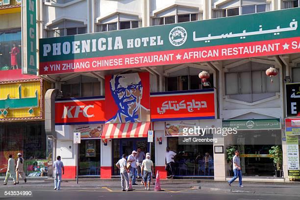 United Arab Emirates UAE UAE Middle East Dubai Deira Baniyas Square KFC Colonel Sanders fast food restaurant hotel street scene
