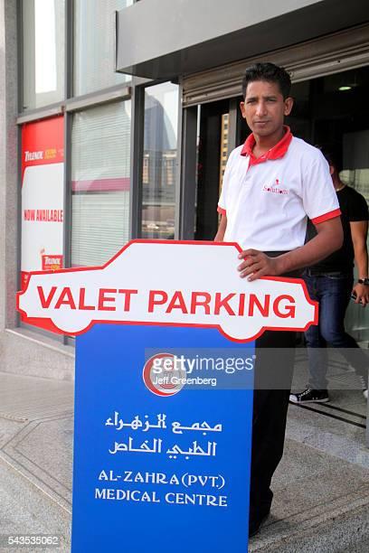 United Arab Emirates UAE UAE Middle East Dubai Trade Centre Sheikh Zayed Road valet parking attendant Asian man migrant worker