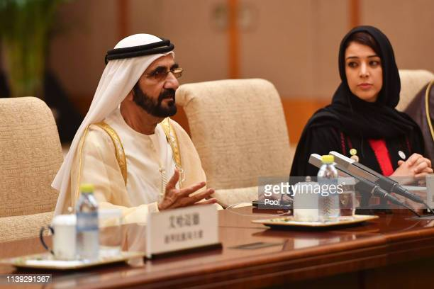 United Arab Emirates Vice President and Prime Minister Sheikh Mohammed bin Rashid Al Maktoum speaks with Chinese Premier Li Keqiang, during their...