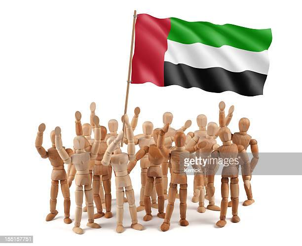 United Arab Emirates - wooden mannequin group with flag