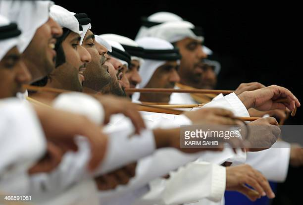 United Arab Emirati men hold canes as they perform a local traditional Bedouin folklore dance during the Sheikh Sultan Bin Zayed alNahyan camel...