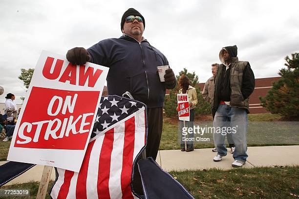 United Auto Worker Donald Groce walks a picket line at a Chrysler parts distribution center October 10 2007 in Naperville Illinois The UAW has called...