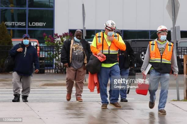 United Auto Workers members leave the Fiat Chrysler Automobiles Warren Truck Plant after the first work shift on May 18, 2020 in Warren, Michigan....