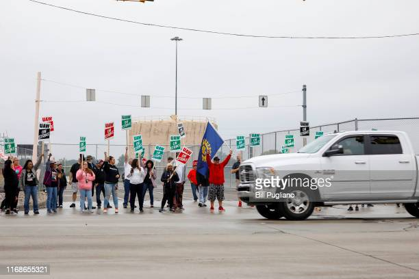United Auto Workers members picket at a gate at the General Motors Flint Assembly Plant after the UAW declared a national strike against GM at...