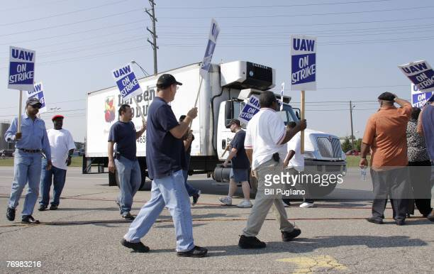 United Auto Workers members strike the General Motors Powertrain Plant and block a truck from entering after a union imposed strike deadline of 11am...