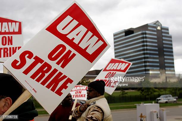 United Auto Workers members walk off the job and picket at the Chrysler LLC world headquarters after the UAW and Chrysler LLC failed to reach a...