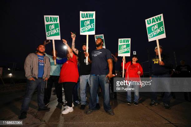 United Auto Workers members walk the picket line at the General Motors Flint Assembly Plant after the UAW declared a national strike against GM at...