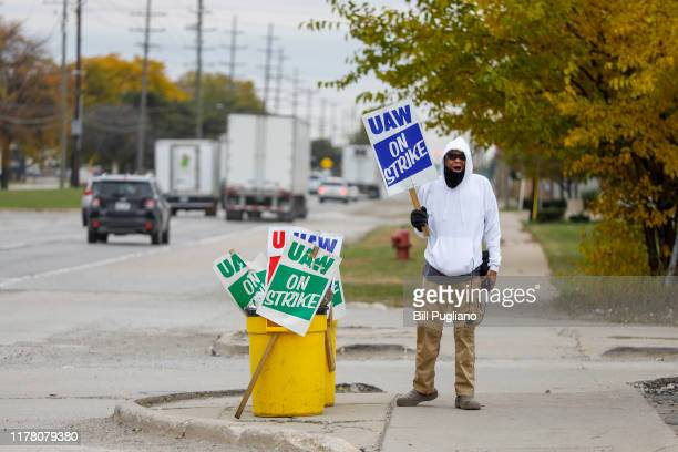 United Auto Workers union member Brian Farr of Detroit, Michigan is the lone picketer at the General Motors Warren Transmission plant on October 25,...