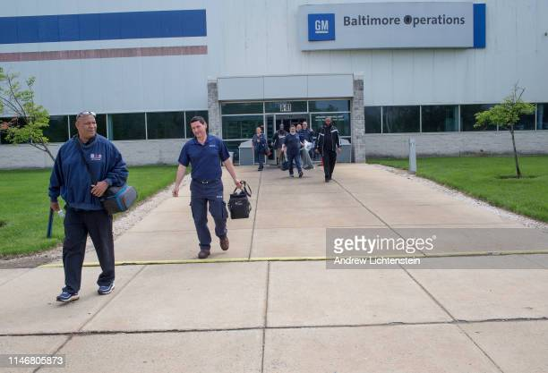 United Auto Workers union members leave the General Motors Baltimore Operations plant for one of the very last shift changes at the factory which is...