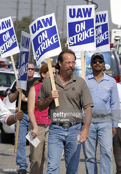 United Auto Workers walk the picket line during a strike at the General Motors Powertrain Plant after a union imposed strike deadline passed...