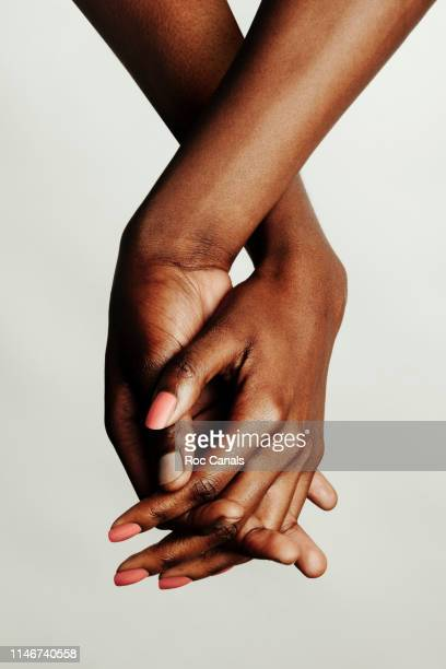 united blacks - touching stock pictures, royalty-free photos & images