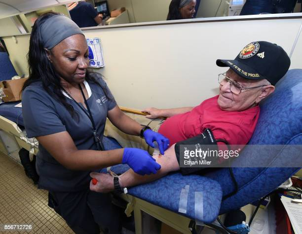United Blood Services phlebotomist ShaNa Hill takes blood from Richard Williams of Nevada at a special United Blood Services drive at a University...