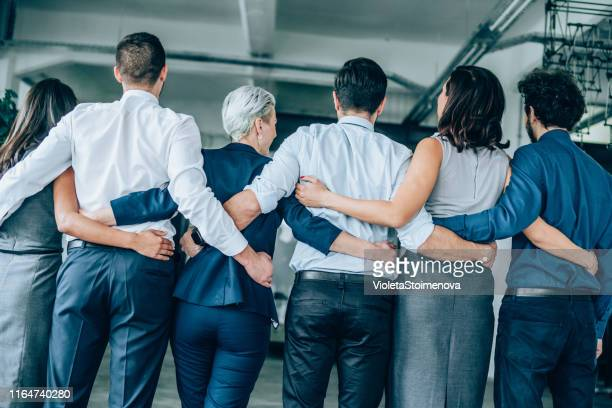 united business team - arm around stock pictures, royalty-free photos & images