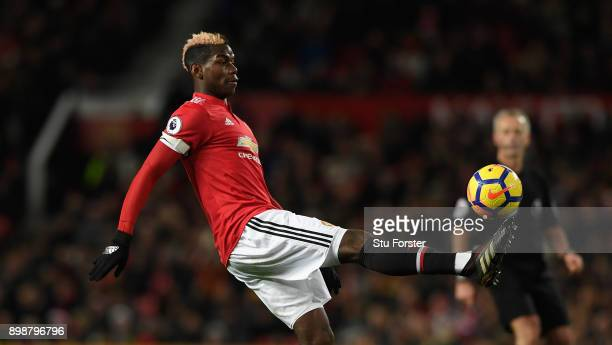 United captain Paul Pogba in action during the Premier League match between Manchester United and Burnley at Old Trafford on December 26 2017 in...
