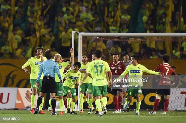United Chiba players protest to referee Nobutsugu Murakami during the JLeague J1 Promotion PlayOff semi final match between Nagoya Grampus and JEF...