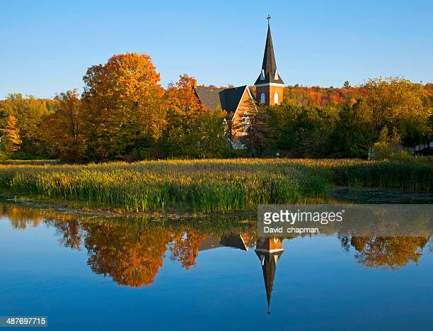 united church, circa 1895, reflected in mill pond, knowlton, eastern townships, quebec, canada - eastern townships stock pictures, royalty-free photos & images