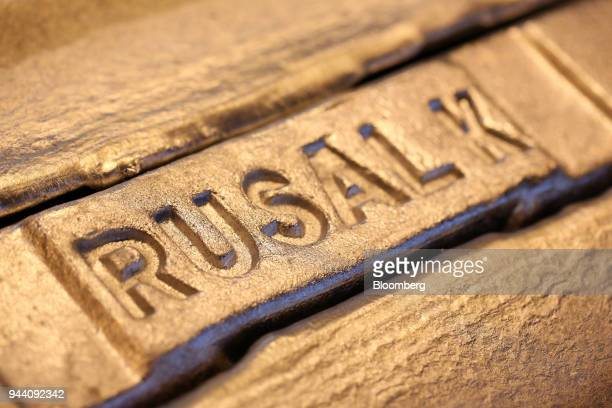 United Co Rusal logo sits on an aluminum ingot in a warehouse at the foundry in the Krasnoyarsk aluminum smelter operated by United Co Rusal in...