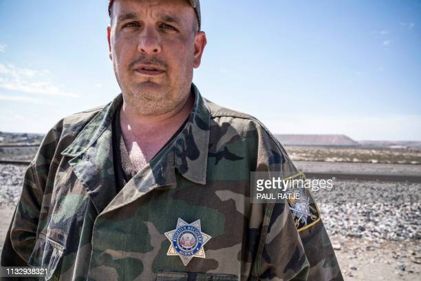 United Constitutional Patriots New Mexico Border Ops militia team member Jim Benvie from Minnesota looks on near the USMexico border wall in Anapra...