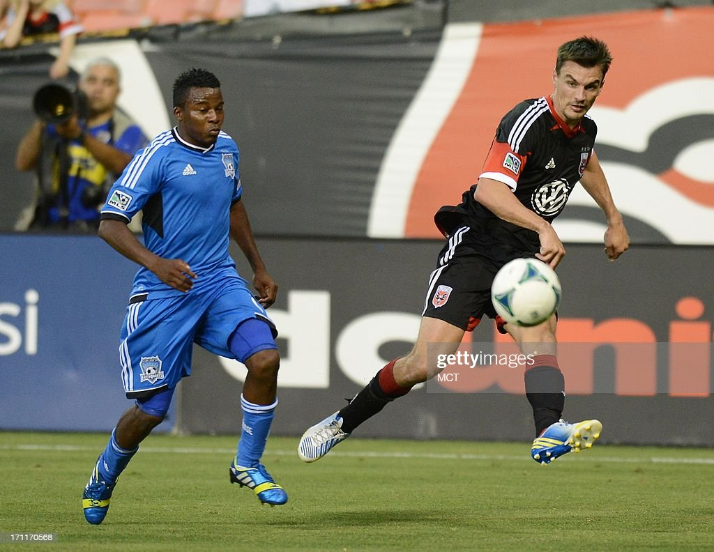 D.C. United defender Alain Rochat (25), right, shoots a crossing pass past San Jose Earthquakes midfielder Marvin Chavez (81) in the second half at RFK Stadium in Washington, D.C., Saturday, June 22, 2013. United defeated the Quakes, 1-0.