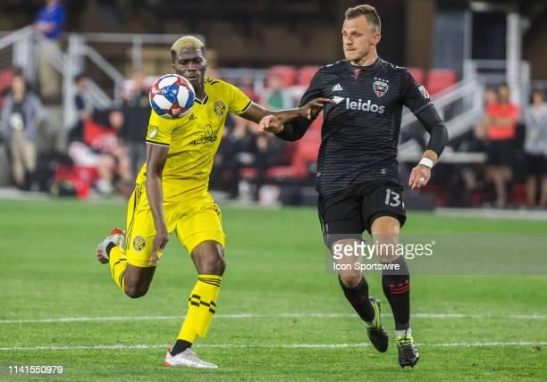 C United defender Frederic Brillant and Columbus Crew forward Gyasi Zerdes go for the ball during a MLS match between DC United and Columbus Crew SC...