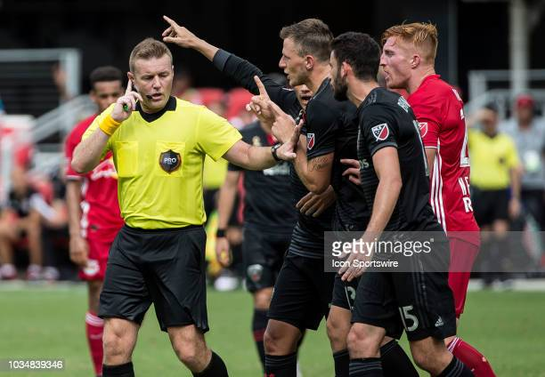 C United defender Frederic Brillant argues with referee Alan Kelly during a MLS match between DC United and the New York Red Bulls on September 16 at...