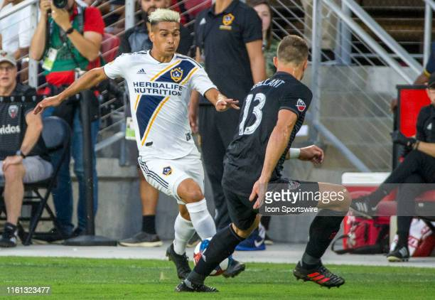 C United defender Frederic Brillant defends against Los Angeles Galaxy forward Favio Alvarez during a MLS match between DC United and the LAGalaxy on...
