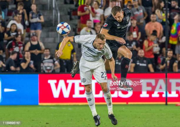 C United defender Frederic Brillant heads over Philadelphia Union forward Kacper Przybylko during a MLS match between DC United and the Philadelphia...