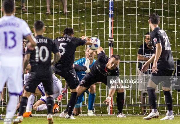 C United defender Frederic Brillant watches midfielder Junior Moreno clear the ball from the goalmouth during a USOC round of sixteen match between...