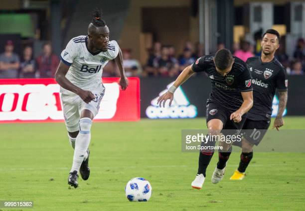 C United defender Joseph Mora chases after Vancouver Whitecaps forward Kei Kamara during a MLS match between DC United and the Vancouver Whitecaps on...