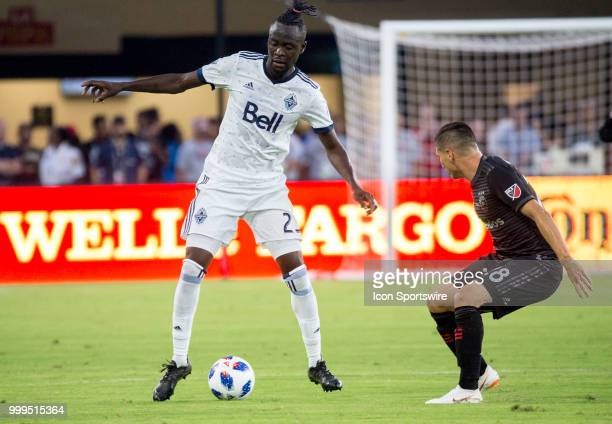 C United defender Joseph Mora defends against Vancouver Whitecaps forward Kei Kamara during a MLS match between DC United and the Vancouver Whitecaps...