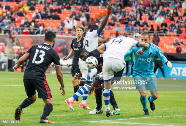 C United defender Kofi Opare and Montreal Impact midfielder Adrian Arregui scramble for the ball during a MLS game between DC United and the Montreal...