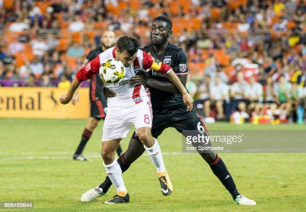 C United defender Kofi Opare holds up San Jose Earthquakes forward Chris Wondolowski during a MLS match between DC United and the San Jose...