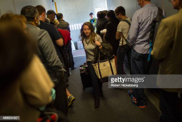 United Express passengers retrieve their carryon bags from ground staff April 18 2014 after arriving at Chicago's O'Hare International Airport United...