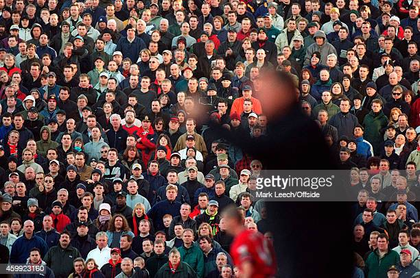 United fans on the terraces with a blurred image of Alex Ferguson in the foreground during the FA Cup match between Fulham v Manchester United at...