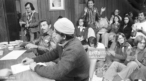 United Farm Workers union members listen to incoming election results Calexico California 1977 Among them Arturo Rodriguez claps his appreciation