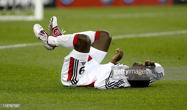 United forward Freddy Adu lies on his back after falling in the second half of the game aginst the New England Revolution at Gillette Stadium in...