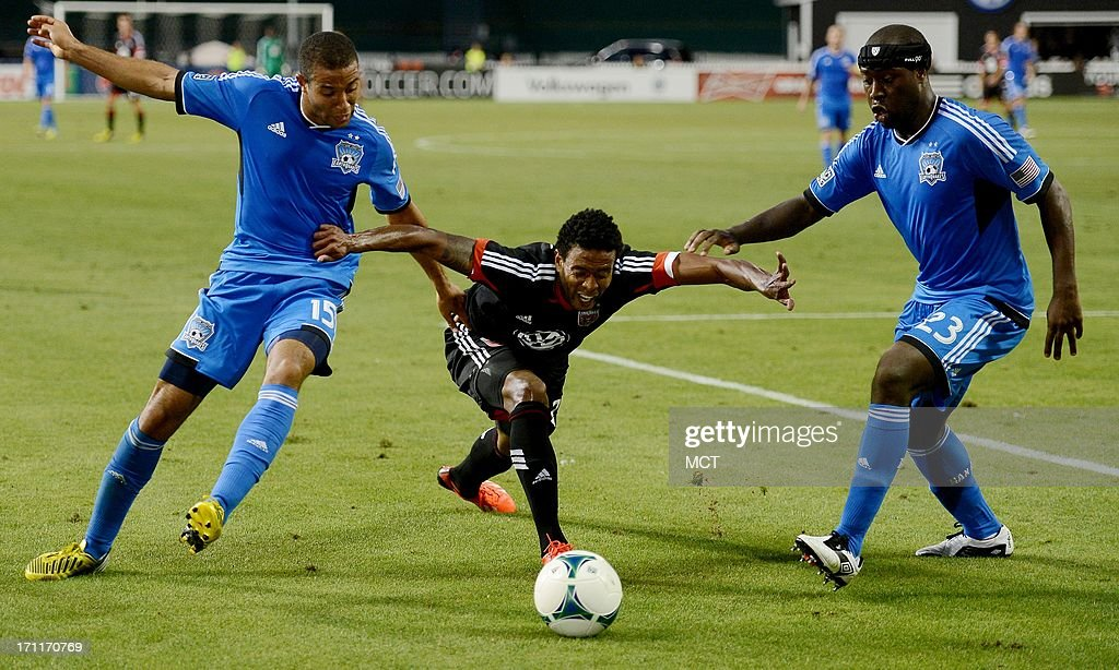 D.C. United forward Lionard Pajoy (26), center, leans forward to reach the ball between San Jose Earthquakes defender Justin Morrow (15) and Earthquakes defender Nana Attakora (23) in the second half at RFK Stadium in Washington, D.C., Saturday, June 22, 2013. United defeated the Quakes, 1-0.
