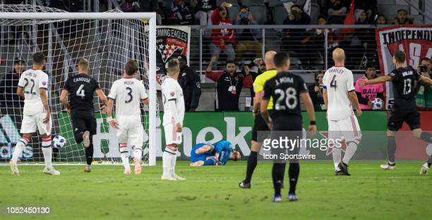 C United forward Wayne Rooney beats Toronto FC goalkeeper Alex Bono for a goal from a free kick during a MLS match between DC United and Toronto FC...